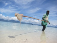 Bajau man with catch,Torosiaje, Indonesia
