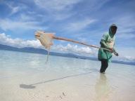 Bajau man with catch,Torosiaje, Indonesia