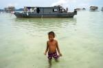 Sama Girl walking from houseboat, MaigaIsland