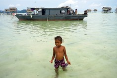 Sama Girl walking from houseboat, Maiga Island