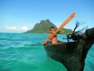 Bajau Laut Boy Paddling Outside of Bodgaya, Semporna, Malaysia