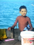 Bajau Laut Boy with Traditional Sunscreen on Houseboat, Semporna,Malaysia