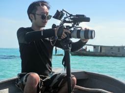 Camera man Recording Bajau Laut Documentary, near Bodgaya, Semporna, Malaysia
