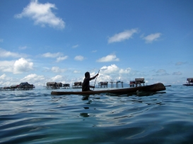 Paddling Through the Village - Bajau Laut Man outside of Bodgaya, Semporna, Malaysia
